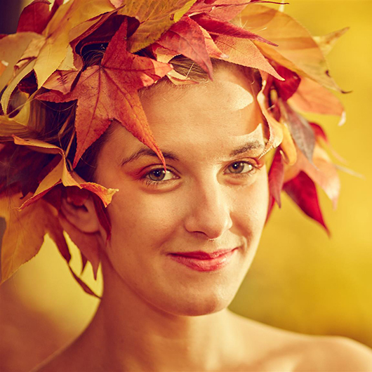 creative process women with leaves over her head freeing her creativity