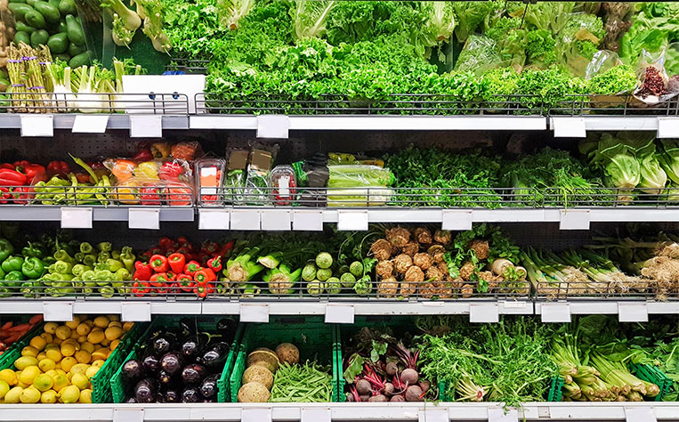 fresh fruits and vegetables at retail store
